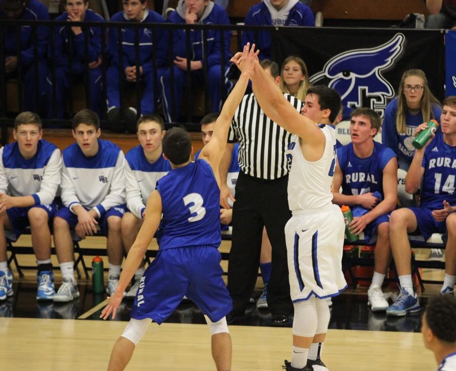 Christian Ozores shoots a jumper against Washburn Rural.