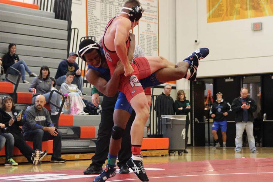 John Clark wrestling Osage opponent