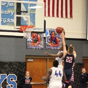 AJ Dickerson going up for a dunk against Manhattan.