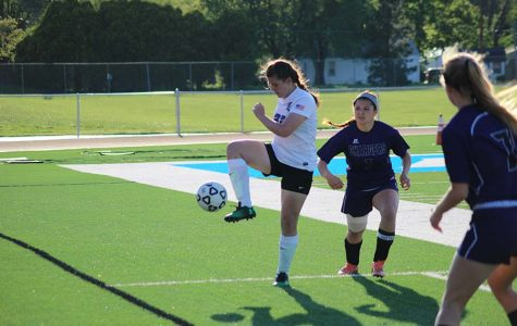 Sophomore, Emma Beamer getting ready to kick the ball.