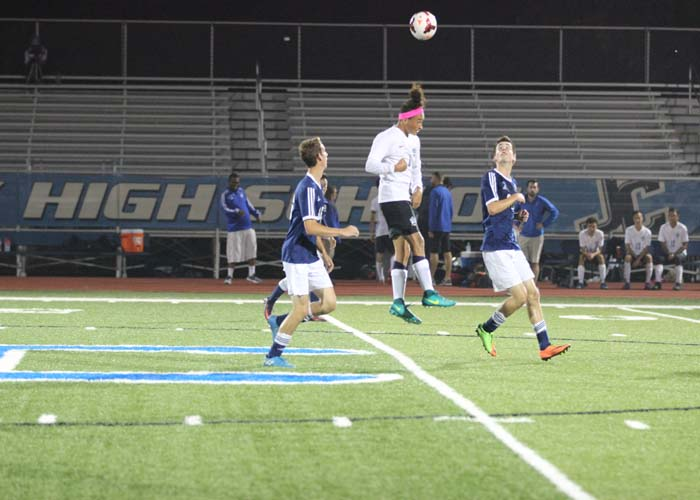 Sergio Perez-Ortiz uses his head to pass the ball to a team mate.