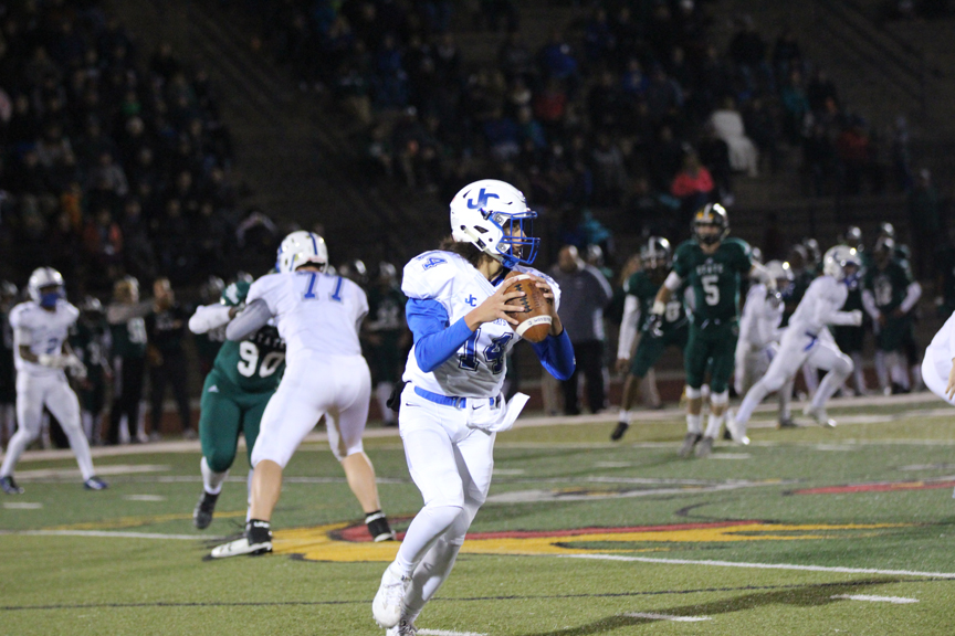 Freshmen quarterback Andrew Khoury gets ready to throw a pass during the 2nd round of 6A Playoffs against Lawrence Free State.