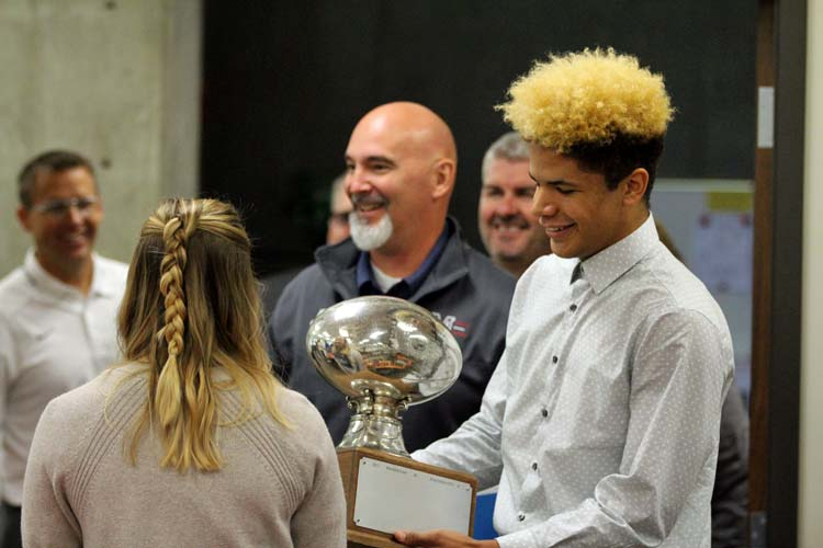 Ethan Alcorn helps bring in the Silver Trophy.