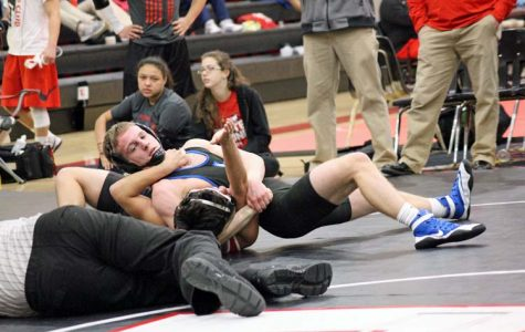Max Bazan pins opponent, William Calixto, from Olathe North at the Emporia Winter Dual.
