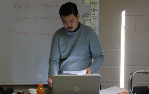 Science teacher, Subin Chun administers a test in Chemistry.
