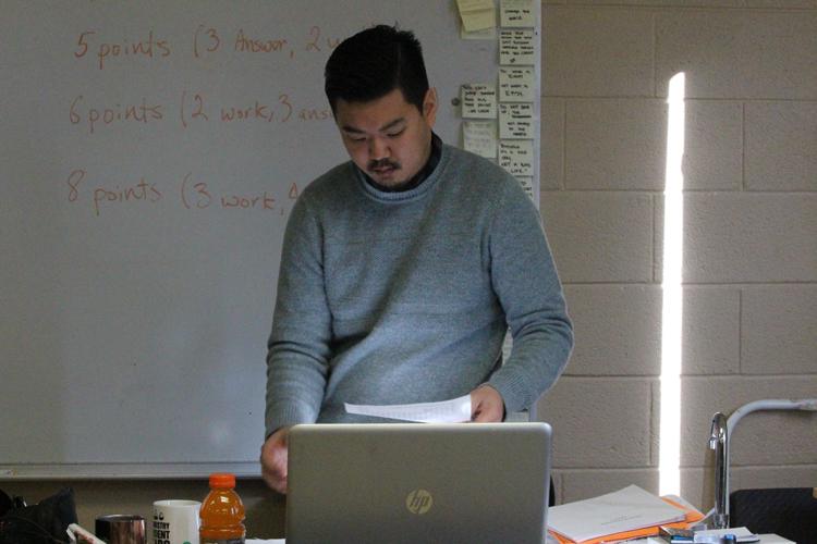 Science teacher, Subin Chun administers a test in Chemistry.