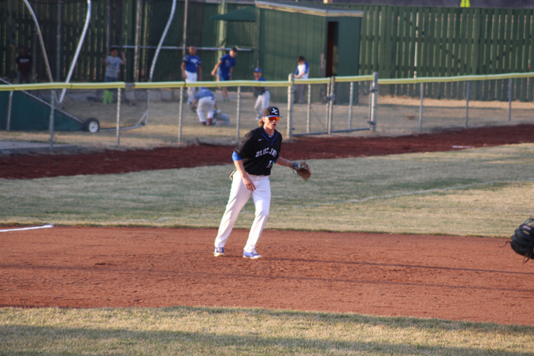 Junior Thane McDaniel anticipates to infield a ball during the Blue and Black scrimmage on Thursday March 22nd.