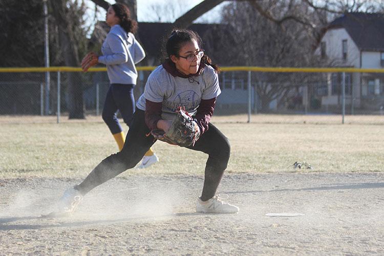 Junior Alidsha Vasquez Centeno fields a ball during practice on March 15th.