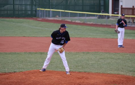 Thane McDaniel getting ready to pitch at the home baseball game April 24th against Seamen.