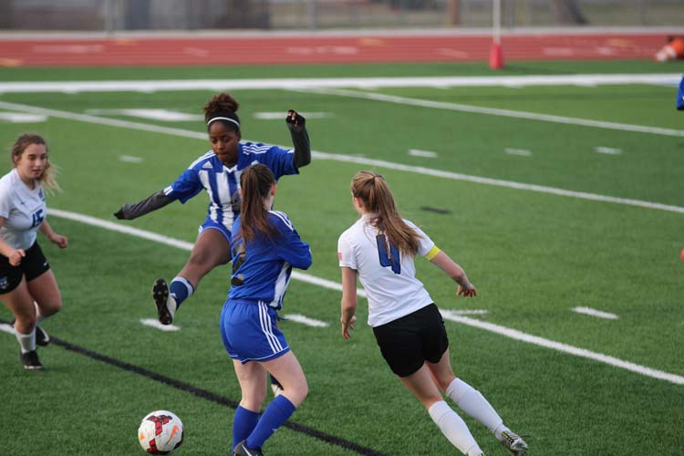 Junior Laura Campbell attempts to steal the ball from the opposing team