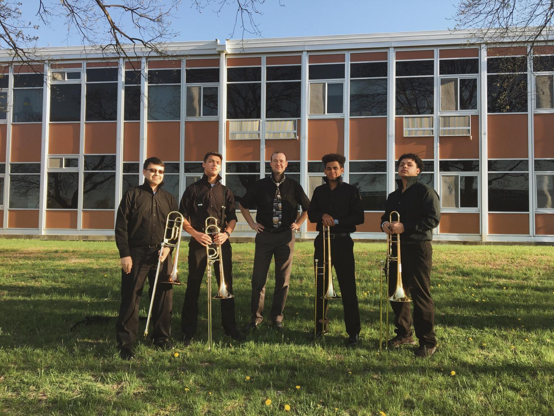 Trombone Quartet members William Osorio, Cody Molloy, Luke Hughes, Calvin Range, and Band Director Jared Morris.