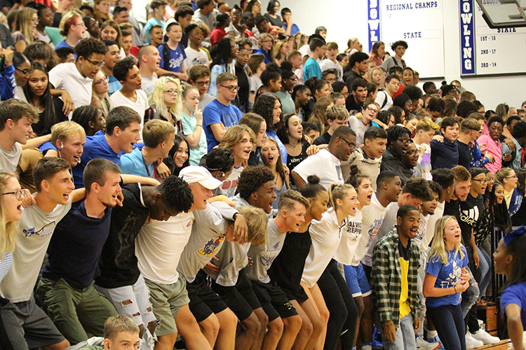 Seniors show their school spirit by participating in the JU chant.