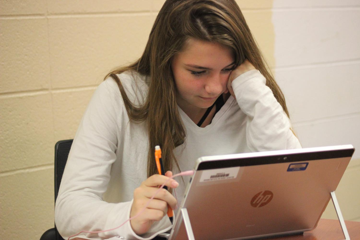 Junior Kaitlyn Elliot works on Algebra 2 in a personalized learning class on Friday August 31st.