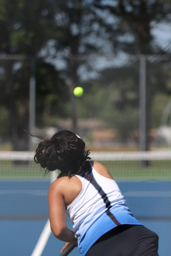 Senior Alidsha Vazquez serves the ball to her opponent at a tennis match on August 30.