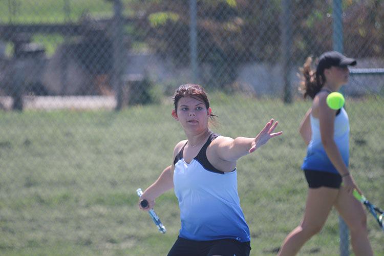 Sophomore Abigail Rosauer serves the ball at the JC tennis quadrangular on August 30.