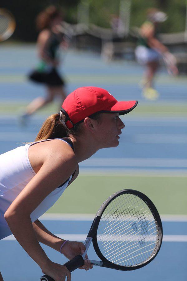Junior Erilinne Thornton prepares to return a serve at the JC tennis quadrangular on August 30.