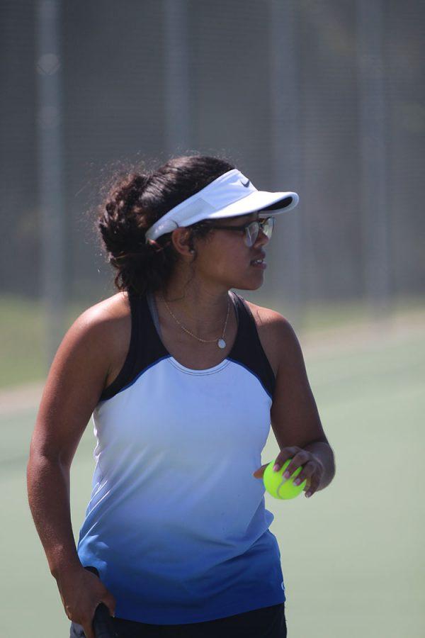 Senior Alidsha Vazquez prepares to serve a ball during a tennis match on August 30.