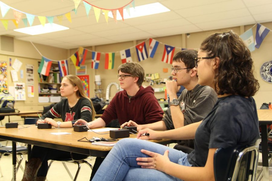 Hailey Eschliman (Junior), Aiden Alexander (Junior), John Reeves (Senior), and Hannah Mancini (Senior) participate in a scholars bowl practice on October 24th, 2018.