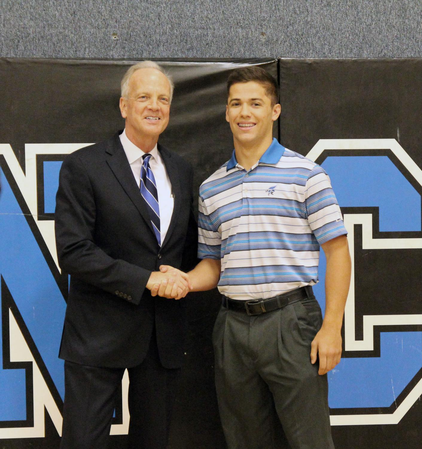 Junction City High School Senior Corbin Sanner receives Senator Jerry Moran's nomination to West Point.