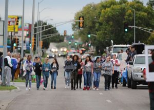 JCHS student stroll through the streets as part of the homecoming parade.
