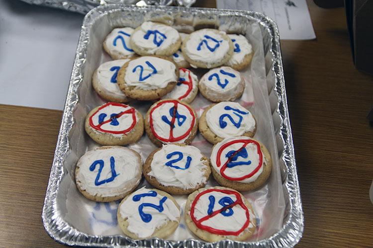 Kody Westerhaus, Juan Tovar, and Corbin Sanner made cookies to represent fiscal federalism.