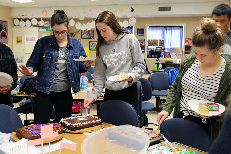 (From Left to Right) Morgan Deering, Reece Boland, and Annalee Pellicotte eating cake after they had all been presented.