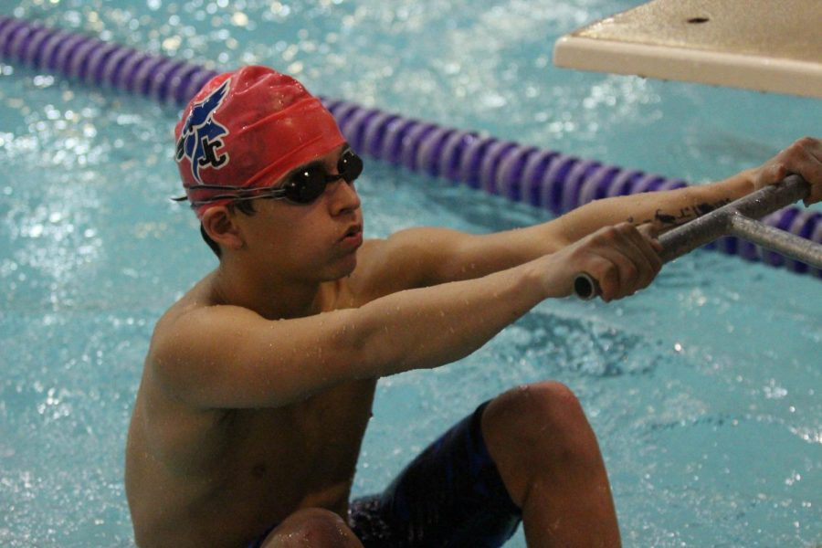 Junior+Adrian+Robles+prepares+for+a+backstroke+start+at+a+meet+in+Manhattan+on+January+9%2C+2019.+