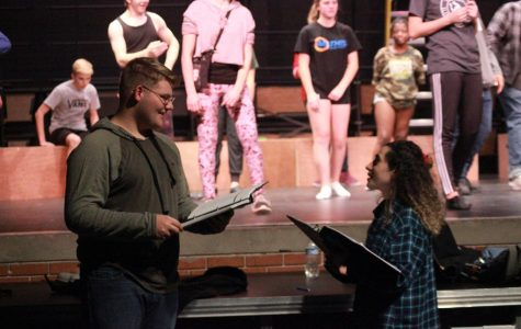 Senior student directors Charles (Dillon) Powell and Merve Aksu discussing the Pippen musical during rehearsal on January 18.