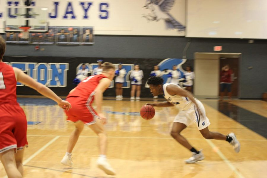 Senior AJ Dickerson drives to the basket on Saturday February 2nd against Emporia Spartans.