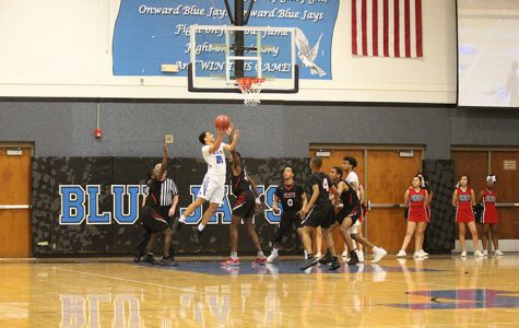 Junior Darrin Battiste Jr shoots a lay up against Highland Park on February 8.
