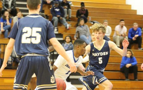 Senior, Aaron Hamilton drives the ball against a Hayden Player on Tuesday, Jan 29.