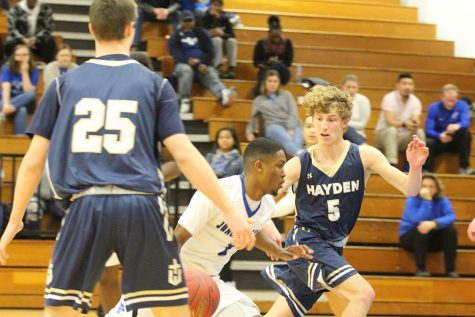 Boys Basketball Defeat Hayden, Move On To Topeka Trojans