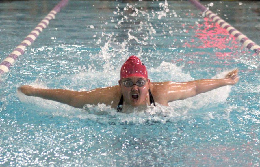 Sophomore Lauren Kim swims the butterfly stroke.