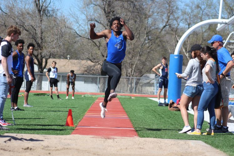 Sophomore DJ Giddens competes in the long jump event at the home track meet on April 9, 2019.