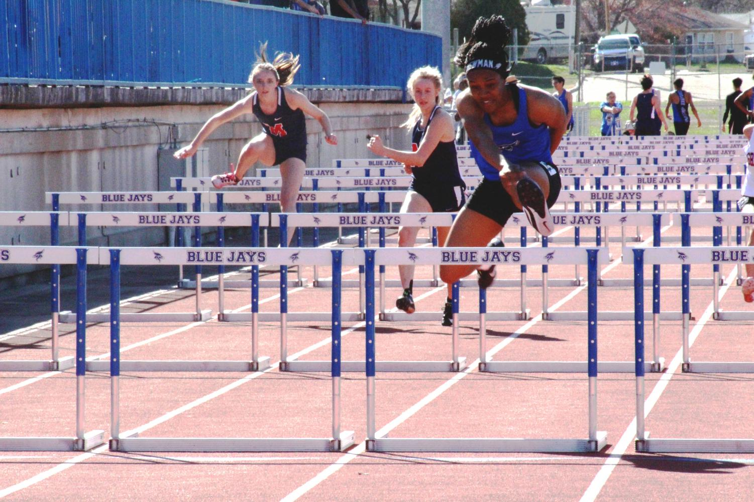 Keiana Newman, two-time state champion in the 100-meter hurdle, competes in hurdles at the home track meet on April 9, 2019.