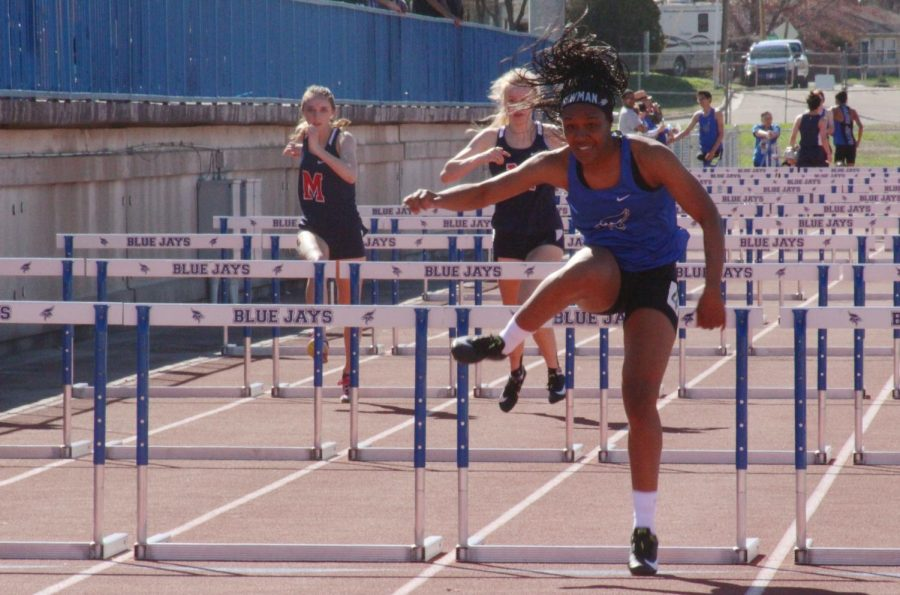 Keiana Newman, former state champion, competes in hurdles at the meet on April 9, 2019.