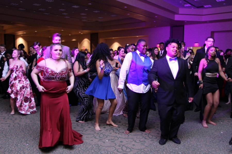 Students dance at prom which was held at the Courtyard Marriott on  April, 13.