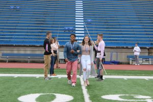 Senior Laynee Chase and Senior Albert Coba de Mota practicing their walk for the crowning