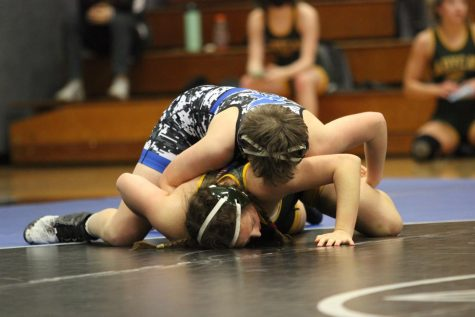 Junior Brooke Swango works to rotate her opponent to her back for the pin. Swango was one of five wrestling to compete at state. Although she didn