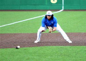 Senior Andrew Khoury fields the ground ball.